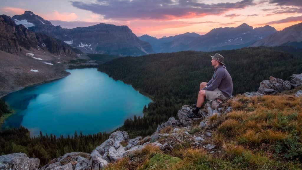 man over looking lake in banff national park