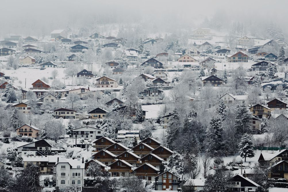 Birds eye view of a quint skiing town, covered in snow