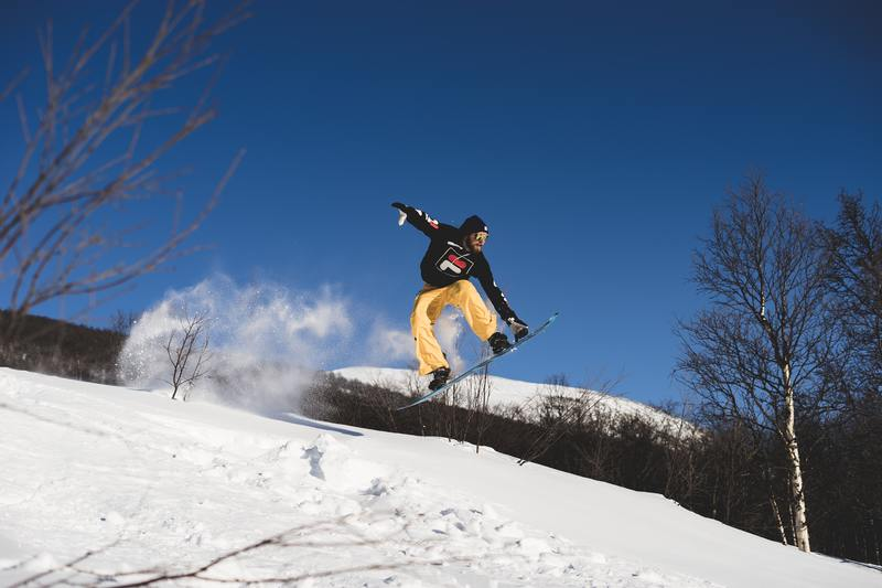 Snowboarder jumping on a slop