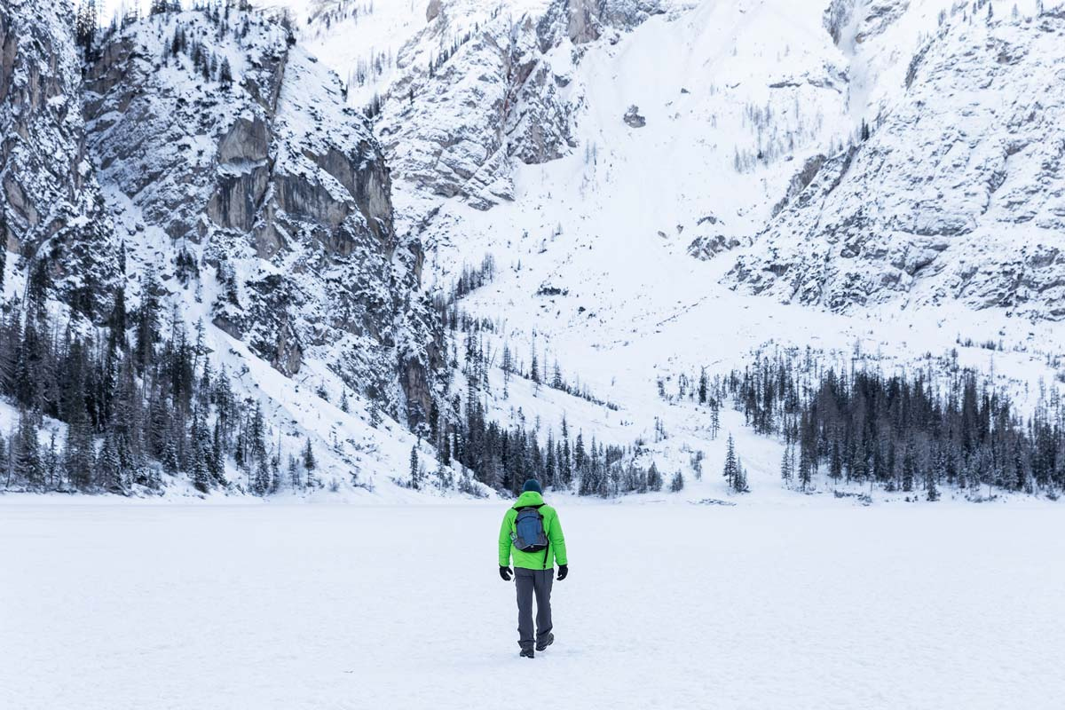 hiker wearing green jacket and winter gloves