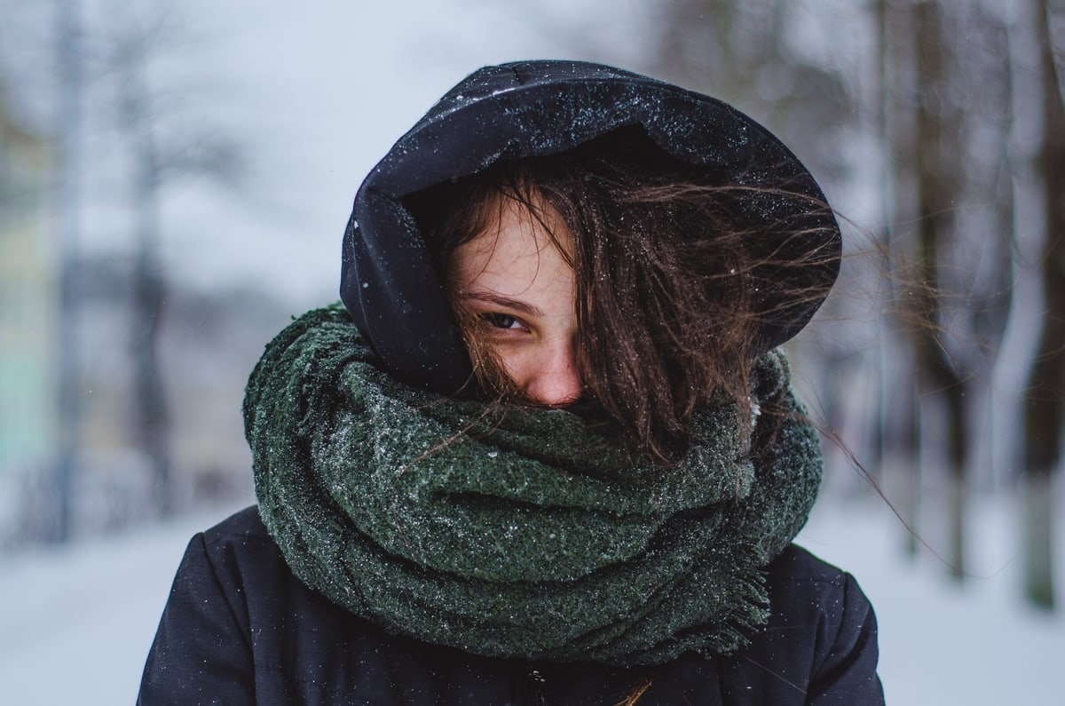 woman-face-covered-scarf-cold