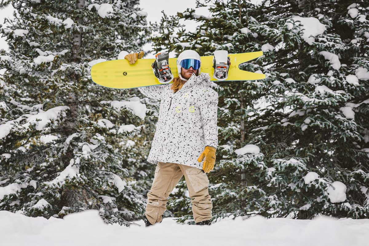 Yellow snowboard gloves being worn by a male