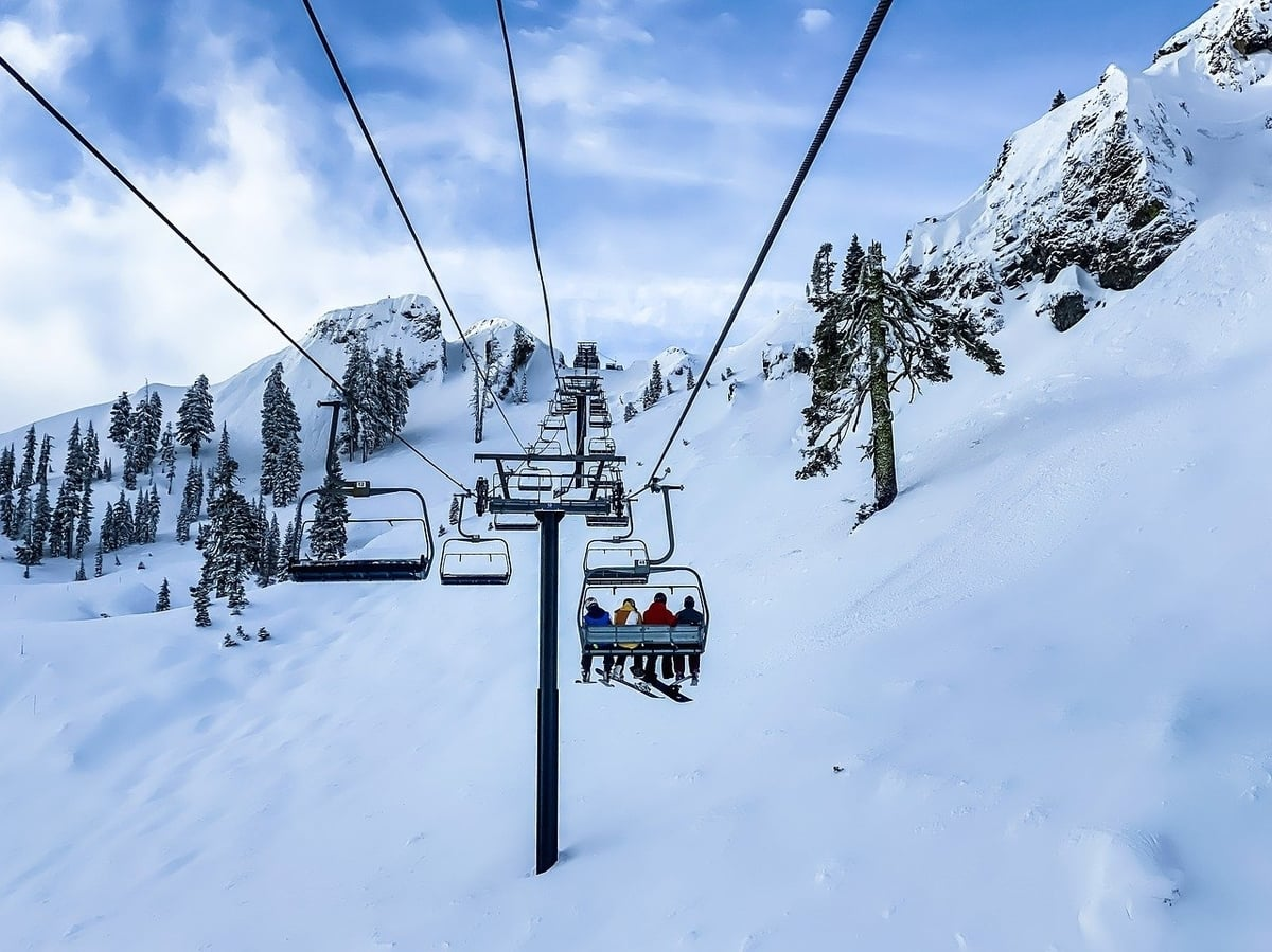 Ski lifts over snowy mountains