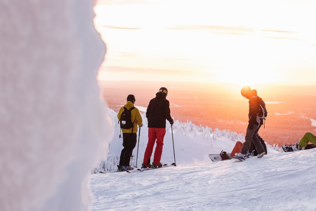 Snowboarders admirning the view