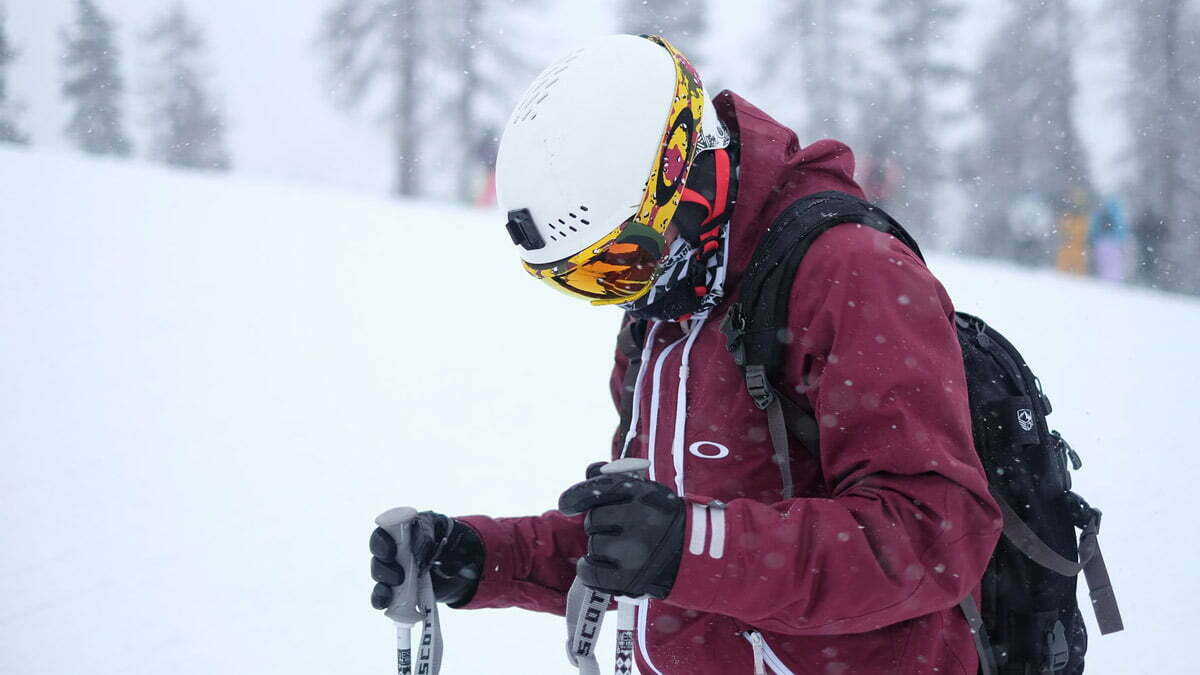Skier with helmet, goggles, and gloves