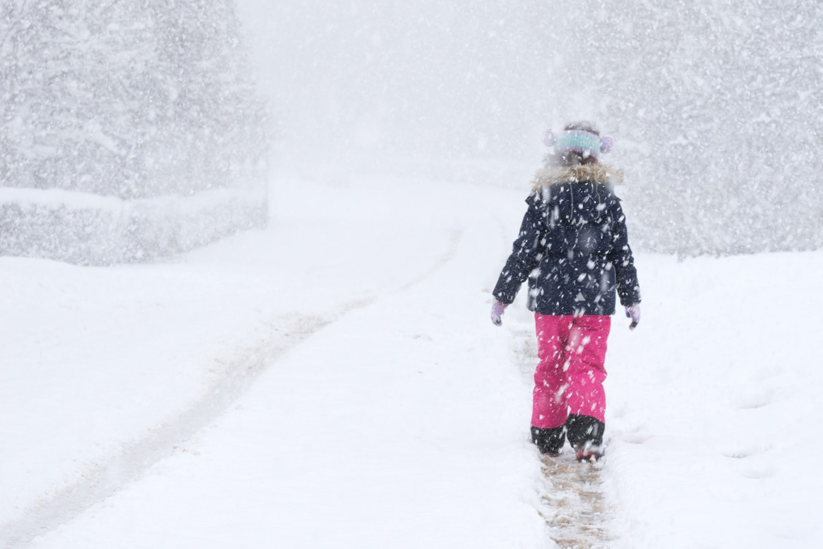 warmly dressed kid in snow