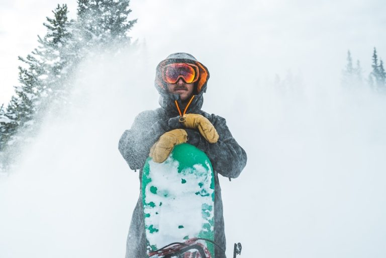 person standing with snowboard