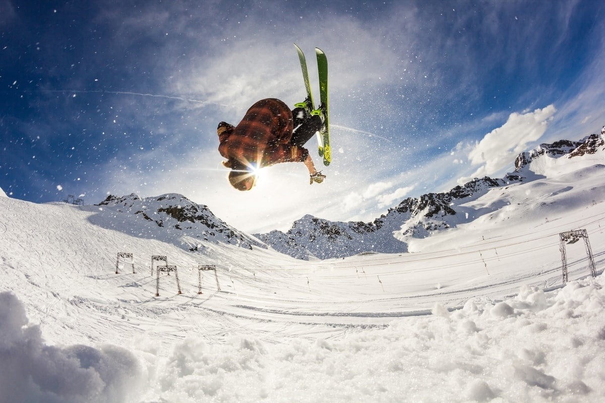 skier does a somersault mid air