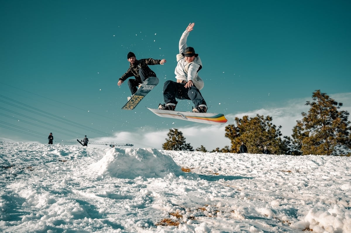 snowboarder-jump-mid-air-down-slope