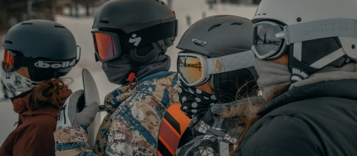four-skiers-wearing-ski-helmets-and-goggles
